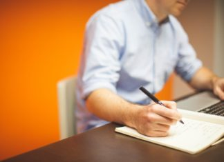 Man taking notes for IT certifications